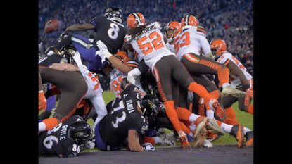 Baltimore Ravens quarterback Lamar Jackson (8) fumbles at the goal line in the second quarter of the Ravens 26-24 win over the Cleveland Browns.