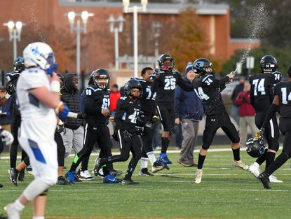 Pallotti celebrates the win. St. Vincent Pallotti defeated St. Mary's, 42-0, in the MIAA B Conference championship game at Archbishop Spalding High School in Severn.