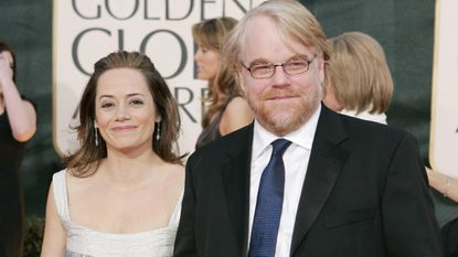 Philip Seymour Hoffman and Mimi O'Donnell attend the 63rd Golden Globe Awards in 2006.