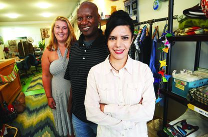 Left to right, Tembo shop manager Mary de la Reguera and artists Alexis Safali and Rebecca Zamani at the store in Fells Point.