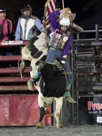 Hampstead resident Kegan Mayo, 16, rides a bull at the Maryland High School Rodeo Association's Battle By the Bay in October.