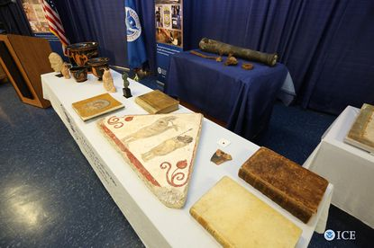 Displayed on a table are some of the 19 artifacts recovered by Homeland Security Investigations for return to Italy.