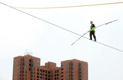 Tightrope walker Nik Wallenda is walking over the harbor to mark the opening of the new Ripley's Museum.