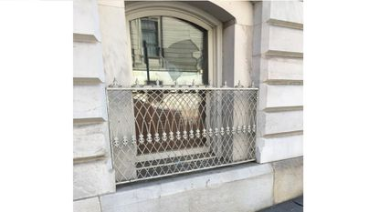 Four windows at Baltimore City Hall, including this one, were shot at with a BB gun, police say.