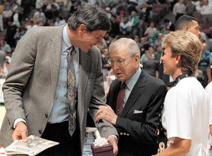 Former UCLA star basketball player Dave Meyers, left, with former coach John Wooden, in 1995.