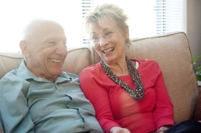 John and Dawn Strumsky reminisce as they retell the story of how they first met from the couch of their apartment at Charlestown Retirement Community in Catonsville, Monday, Sept. 14, 2015.