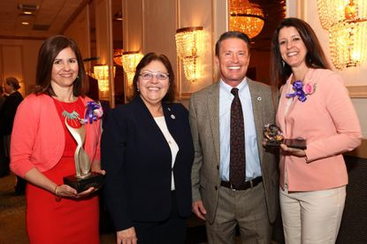 Dr. Dianna G. Phillips, president of Harford Community College (second left), and Harford County Executive Barry Glassman congratulate Kathy Walsh, director of marketing for Fallston Group (left), who received the ATHENA Leadership Award and Paige Boyle, director of marketing and customer relations for Boyle Buick GMC, recipient of the ATHENA Young Professional Award. The awards were presented at a breakfast at the Richlin Ballroom on March 3.