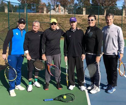 "From left, tennis buddies Kurt Reser, Paul Dobyn, Chuck Zorbach, John Byrnes, Chuck Franklin and Dave Ptak get together for the ""First Annual John Kirkpatrick Invitational"" in memory of their friend, John Kirkpatrick, who died in December. Kirkpatrick's racket is in the foreground. Not pictured are Joe Spurrier and Mackie Cromwell."