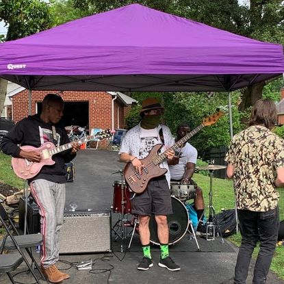 John Tyler, left, and The Neighborhood band perform jazz/rock fusion on the World Music Stage in Towson's Knollwood community on June 20.