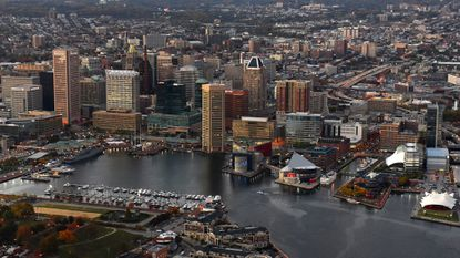 Bad Baltimore headlines aside, new report shows bump in residents and jobs downtown