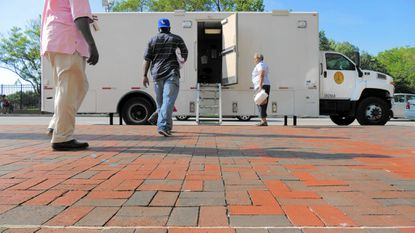 The city's mobile HIV testing truck stops on Monument Street near Old Town Mall.