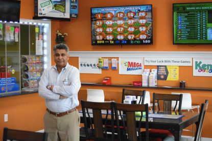 Riaz Ahmad, an owner of a BP gas station on Baltimore National Pike in Catonsville, relies on sales of lottery tickets and games to help boost the bottom line.