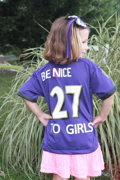 Brynn Bartlett, age 6, of Ellicott City, sports a redesigned Ray Rice jersey, courtesy of her parents, Bryan and Angie.