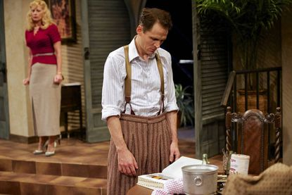 "Joey Collins as ""F. Scott Fitzgerald"" (in background Angele Pierce as Miss Montaigne) in Mark St. Germain's ""Scott and Hem in the Garden of Allah"" at the Contemporary American Theater Festival."
