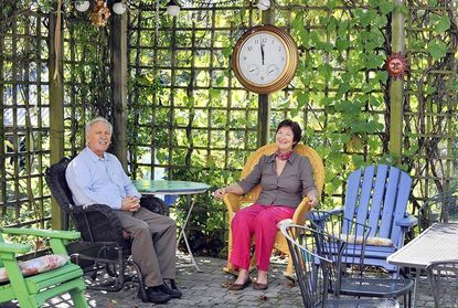 Tom and Rose LeBlanc enjoy the covered patio at their Cape Cod-style home in Fallston.