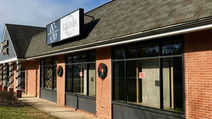 The empty storefront windows of Lutherville consignment boutique Karma are shown on Nov. 29 after the store was emptied by one of its co-owners amid a business partner dispute the night of Nov. 18.