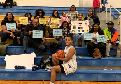 River Hill senior Saniha Jackson poses for a photo with her family after scoring her 1,000th career point in the Hawks' win over Atholton in the MPSSAA Class 3A East Region II semifinals on Monday, March 2, 2020.