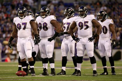 Ravens defensive linemanKapron Lewis-Moore waits to line up against the San Francisco 49ers in an NFL preseason game at M&T Bank Stadium on Aug. 7, 2014 in Baltimore.