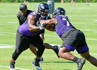 From left, DTs Brandon Williams and Justin Ellis take part in a drill at the Baltimore Ravens Mandatory Team Minicamp on Tuesday morning at the Under Armour Performance Center. June 15, 2021.