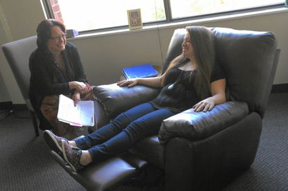 Natalie Scimonelli, right, of Thunder Hill works with Certified Consulting Hypnotist Racquel Knight of Clemens Crossing on career focus and visualizing success during a hypnosis session at Hypnosis Columbia on Tuesday, Oct. 28, 2014.