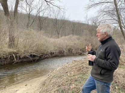 Doug Carroll, who lives on farmland along the Jones Falls in Baltimore County, describes heavy erosion he's seen from flooding and heavy rainfall in recent years.