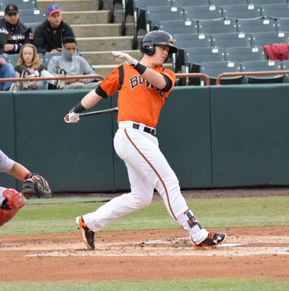 Catcher Chance Sisco swings during a game with the Bowie Baysox.