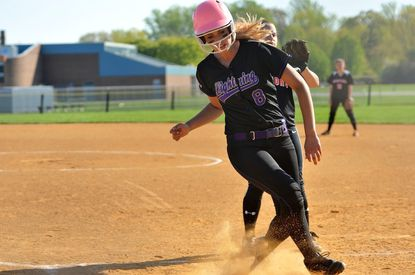 Long Reach senior Noelle Colligan crosses home plate during the a 15-2 Lightning victory over Oakland Mills on Thursday.