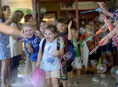 Kindergarteners, from left, Bryson Bosley, Anna Blizzard, Raelynn Gribble (blue, center), and Mason Bucci head to the buses at dismissal on the last day of school at Hampstead Elementary School in 2018. Hampstead Elementary School was named one of six Maryland Blue Ribbon Schools, the first Carroll County recipient of the annual recognition since 2013.