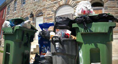 """Trash and the stench of rotting garbage accumulated at the 1200 block of N. Montford Avenue in Baltimore last summer. (""""Karl Merton Ferron/Baltimore Sun)."""