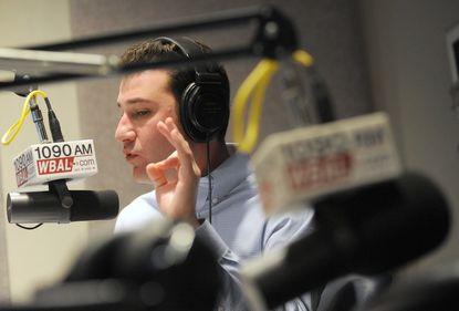 Brett Hollander working in the radio studio at WBAL in 2011.
