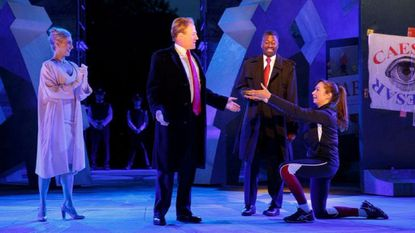 Delta Air Lines is pulling its sponsorship of New York's Public Theater for portraying Julius Caesar as the Donald Trump look-alike in a business suit who gets knifed to death on stage. . (Joan Marcus/The Public Theater via AP)