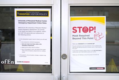 A sign with the updated visitor policy at University of Maryland Medical Center's Midtown campus Thu., Aug. 13, 2020. (Karl Merton Ferron/Baltimore Sun Staff)