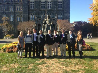 From left to right: Claire Lawson, Dr. Anouar Boukhars, Keegan Farley, Syed Ali, John Collins, Cody Knipfer, Cole Harris, David Whalen, and Phoebe McHale.