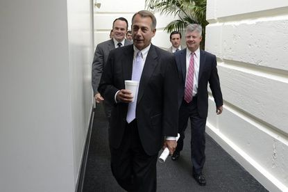 Speaker of the House John Boehner walks into a meeting with House Republicans on Capitol Hill in Washington on Sept. 28.
