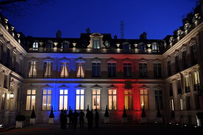 The facade of the Interior ministry is enlighted with French flag's colours prior to a government's meeting in Paris. The country has been accused of protecting a pedophile because he was a literary genius.