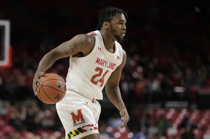 Maryland forward Donta Scott drives against Rhode Island during the first half of an NCAA college basketball game, Saturday, Nov. 9, 2019, in College Park, Md. (AP Photo/Julio Cortez)