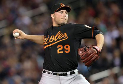 Tommy Hunter delivers a pitch against Minnesota.