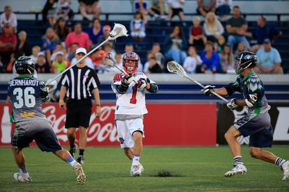 Will Manny of the Boston Cannons passes the ball against the Chesapeake Bayhawks during the first half at Navy-Marine Corps Memorial Stadium on June 14, 2014 in Annapolis, Maryland.