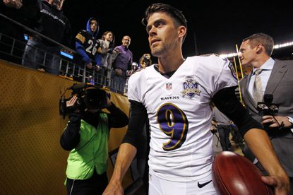 Ravens kicker Justin Tucker leaves the field after kicking the winning field goal in overtime to beat the Steelers.