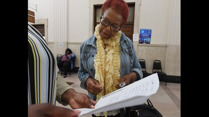 """Baltimore City resident Barbara Holton was given a hand-written dated """"receipt"""" by a supervisor in the City's Tax Sale office stating that she made a payment by checks."""