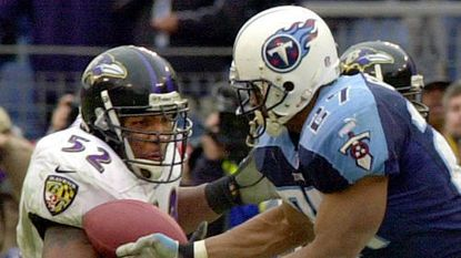 Middle linebacker Ray Lewis, left, picks off a pass that deflected off the hands of Titans running back Eddie George, right, in the fourth quarter of the Ravens' 24-10 victory over the Titans on Jan. 7, 2001. Lewis returned the interception 50 yards for a touchdown.