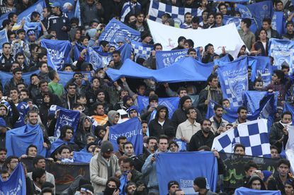 Iranian female soccer fan 'blue girl' dies after setting herself on fire