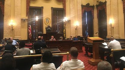 A Baltimore City Council committee delayed a vote until Wednesday on whether to stop adhering to part of the International Fire Code that requires certain road widths and building access requirements.