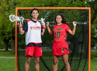 Dulaney senior Justin White and his younger sister Sammy White have both earned Division I lacrosse scholarships.
