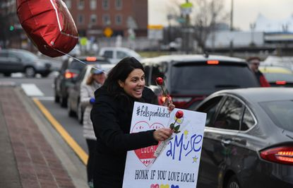 Claudia Towles, owner of Amuse Toys in Fells Point, joined several other local business owners as they greeted drivers and distributed candy and flowers to welcome them downtown at the intersection of Lombard and President Streets. February 12, 2020