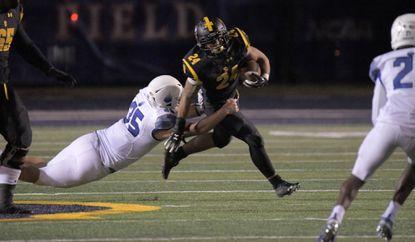 Saint Frances Panthers running back Blake Corum (24) breaks free of IMG Academy Ascenders linebacker Bruce Seton (35) to gain a first down at Morgan State's Hughes Memorial Stadium Fri., Oct. 18, 2019.