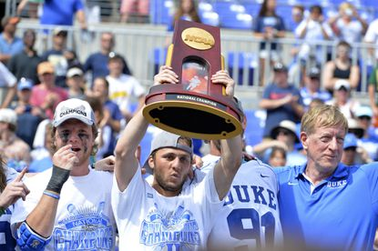 Duke's Jordan Wolf hoisted the national championship trophy on Monday, but Mike Preston doesn't pick him to win the Tewaaraton Award.
