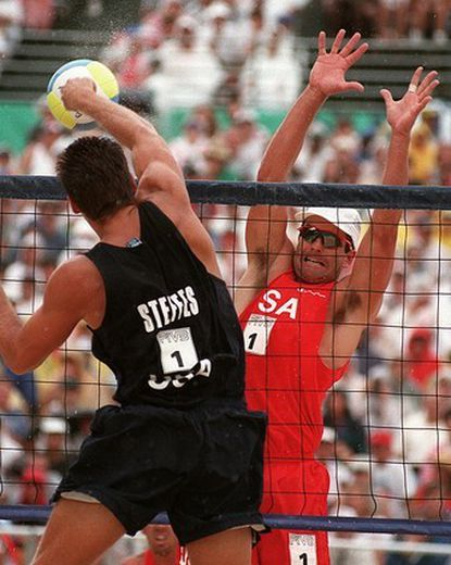 This file photo shows Kent Steffes of the United States spiking the ball against countryman Mike Whitmarsh during their beach volleyball finals at the Summer Olympic Games in Atlanta. Whitmarsh, a 1996 Olympic silver medalist in beach volleyball, killed himself through carbon monoxide poisoning in the garage of a friend's home, officials said on Feb. 18, 2009. He was 46.