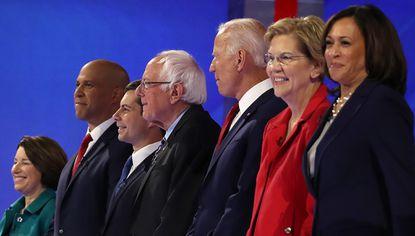 From left, Democratic presidential candidates Sen. Amy Klobuchar (D-Minn.), Sen. Cory Booker (D-N.J.), South Bend, Ind. Mayor Pete Buttigieg, Sen. Bernie Sanders (I-Vt.), former Vice President Joe Biden, Sen. Elizabeth Warren (D-Mass.), Sen. Kamala Harris (D-Calif.), former tech executive Andrew Yang, former Texas congressman Beto O'Rourke, and former housing secretary Julian Castro appear on stage before the start of the Democratic Presidential Debate at Texas Southern University's Health and PE Center on Thursday, Sept. 12, 2019 in Houston, Texas.