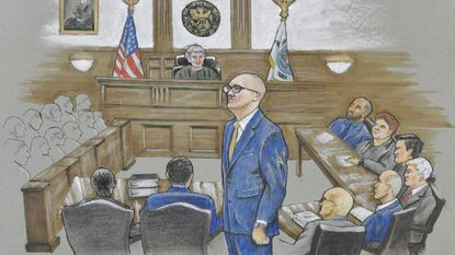 Assistant U.S. Attorney Leo Wise, center, prosecuted the case against two members of the Baltimore Police Gun Trace Task Force, who were found guilty of racketeering and other charges.